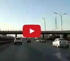 Racing On A Beijing Highway, And Crashing