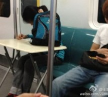 Studying In The Subway, On A Portable Desk