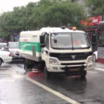 A Beijing Street-Cleaning Truck Decided To Clean The Streets With Water While It Was Raining