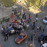 Protesters Surround US Ambassador Gary Locke's Car featured image