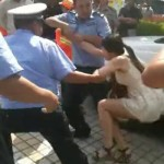 Woman, Wailing And Resisting, Dragged Away By Traffic Cops