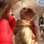 Huntsman rides a bike in Beijing