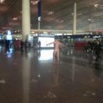 Foreigner streaks in Beijing airport