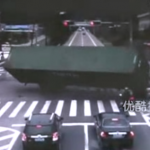 Chinese Motorcyclist Narrowly Avoids Being Crushed Under Overturning Truck