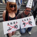 Dunce-Capped Mistress And Cowherd Kneel In Shenzhen To Protest Official Corruption