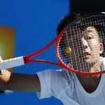 Wu Di of China hits a return to Ivan Dodig of Croatia during their men's single match at the Australian Open tennis tournament in Melbourne