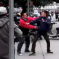 Watch A Cop Almost Do Something About This Fight