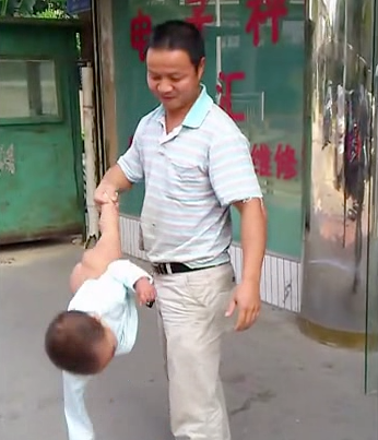 Dad swings baby Shaolin Temple 1