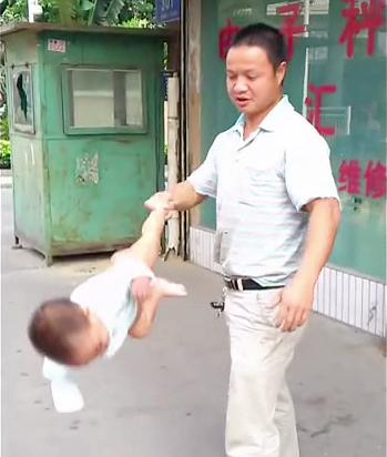 Dad swings baby Shaolin Temple
