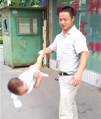 Dad swings baby Shaolin Temple