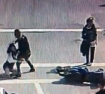 Male And Female Grapple And Kick After Their Scooters Collide