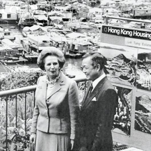 Margaret Thatcher visits the Aberdeen Housing Estate on December 20, 1984, accompanied  by housing official L.K. Chan (Bettmann/CORBIS)