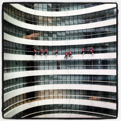 Window cleaners in Beijing by Gabe Clermont