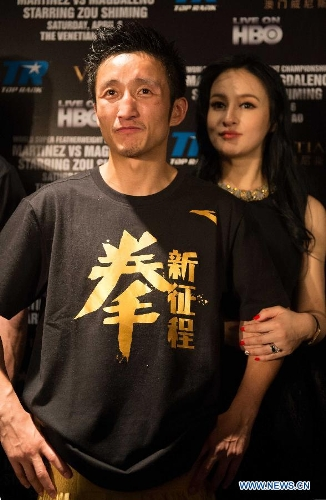 Zou Shiming and wife Ran Yingying
