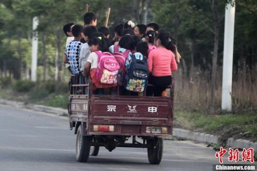 31 kids sit in trike