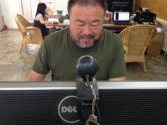 Ai Weiwei checking Twitter reactions