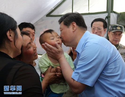 Xi Jinping kisses a baby