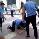After His Buddies Complete The Beatdown, Chengguan Stomps On Fallen Merchant's Head [UPDATE]