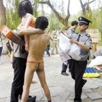 Here's Two Men In Thongs With Blow-Up Dolls At Peking University