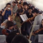 Philadelphia Orchestra in airplane aisle