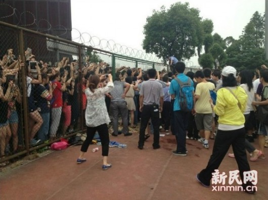 Five hurt in a stampede as fans in China rush to see David Beckham at Shanghai university