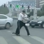 Chinese Traffic Cops Fight On The Job, Hold Up Traffic