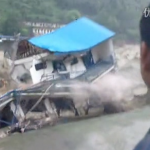 Sichuan Floods Cause Bridge To Collapse, House To Crumble