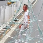 Man In Beijing Smashes Bus Windshield After Falling From Overpass