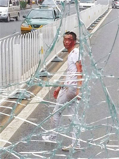Man in Beijing leaps from overpass, shatters bus windshield
