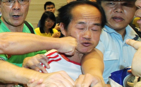 Protester in Hong Kong punched