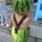 Young Boy Wears Both Halves Of A Watermelon Like A Champ