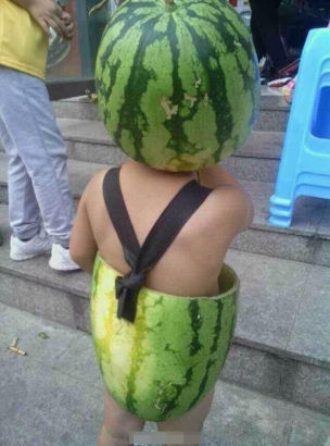 Watermelon-wearing toddler