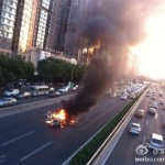 Car on fire on Fourth Ring Road Beijing 1