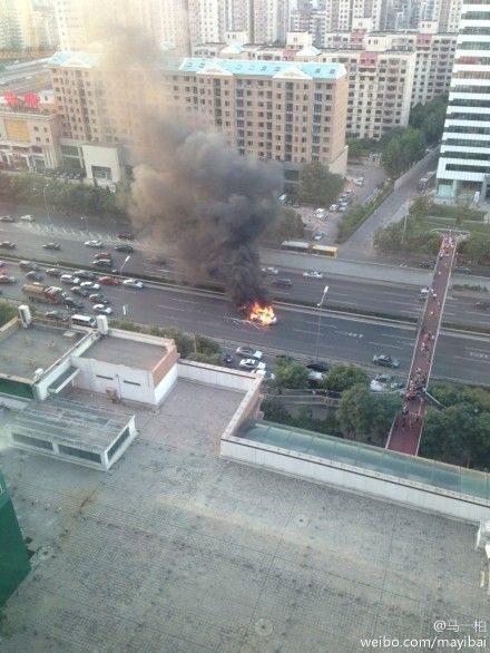 Car on fire on Fourth Ring Road Beijing 2