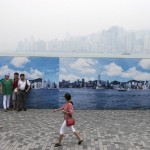 Mainland Tourists Take Photos In Front Of Photo Of Hong Kong Skyline