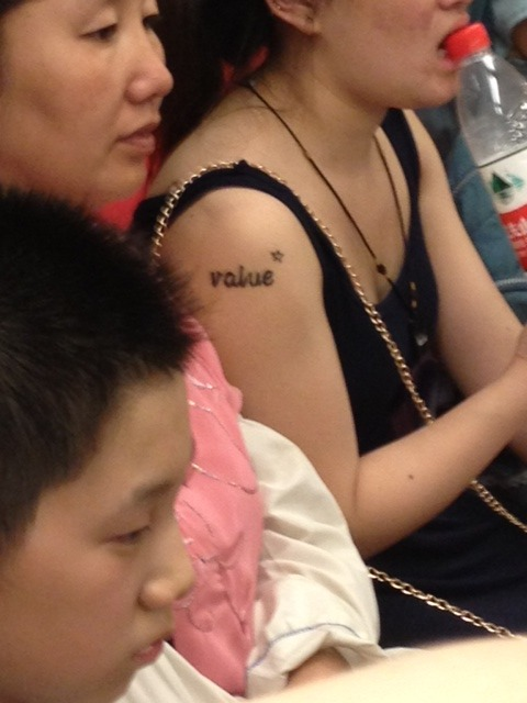 Random word on Asian's arm