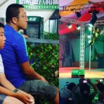 Boy and father watch pole dancing