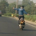 Man on motorcycle without arms