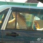 Shanghai residents in back of taxi 1