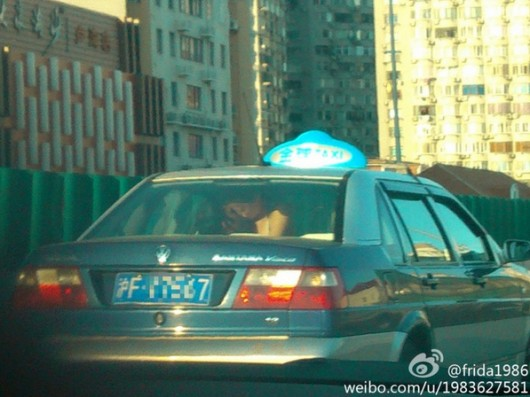 Shanghai residents in back of taxi 2