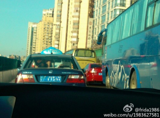 Shanghai residents in back of taxi 3