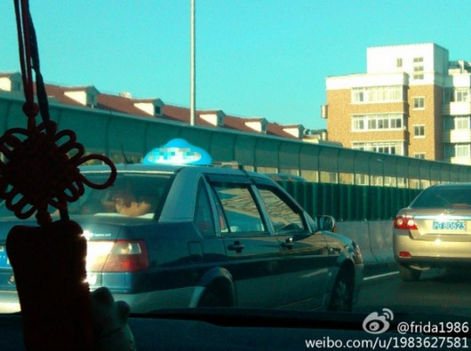 Shanghai residents in back of taxi 4