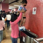 Boy pees into Hong Kong subway trash can