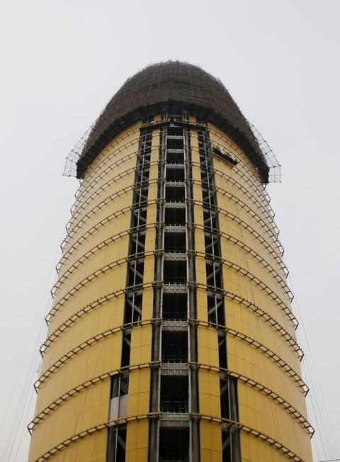 Gold-plated People's Daily penis building