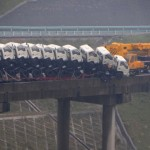Truck Towing Nine Trucks Nearly Falls Off Bridge. Nearly