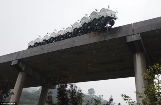Truck nearly falls off Chinese bridge