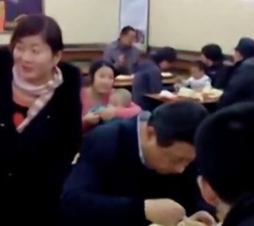 Posing with Xi Jinping