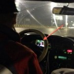Cabbie watches TV while driving
