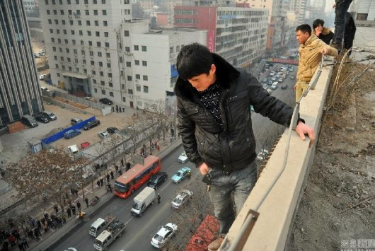 Six men threaten to jump off building due to unpaid wages