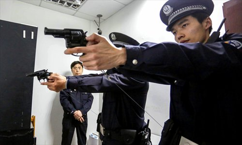 Cop with firearms in Shanghai